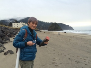 Dr. Isobe holds a Japanese property marker, found on the beach near one of the potential study sites
